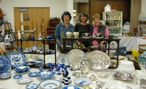 "Volunteers with sale items in ""treasures."""