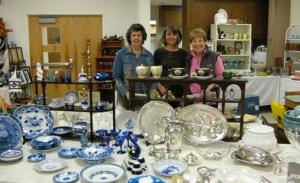 """Volunteers with sale items in """"treasures."""""""